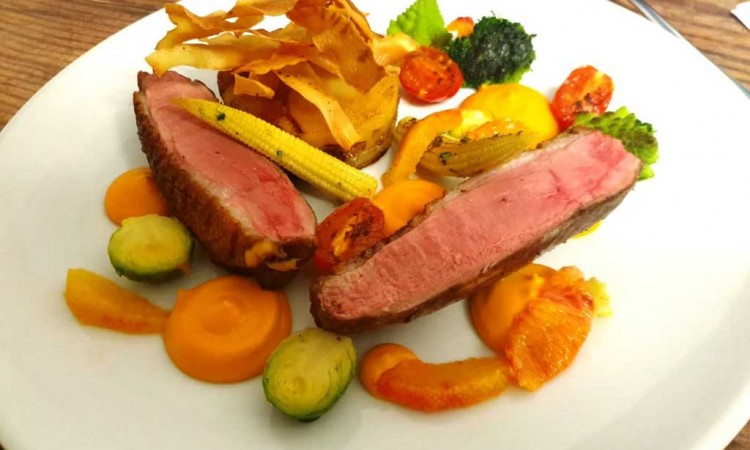 Duck breast with confit leg gratin