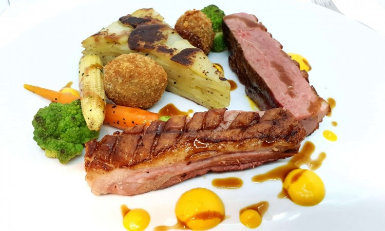Pan fried duck with pommes anna, confit leg croquette and spiced pumpkin-min